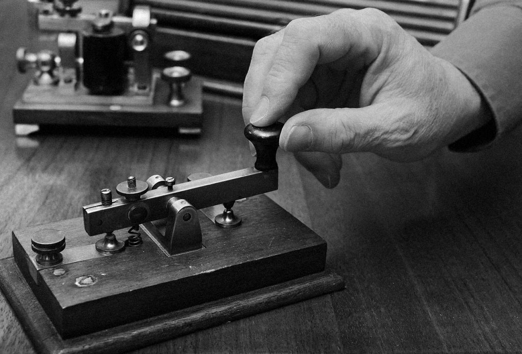 Hand using telegraph machine