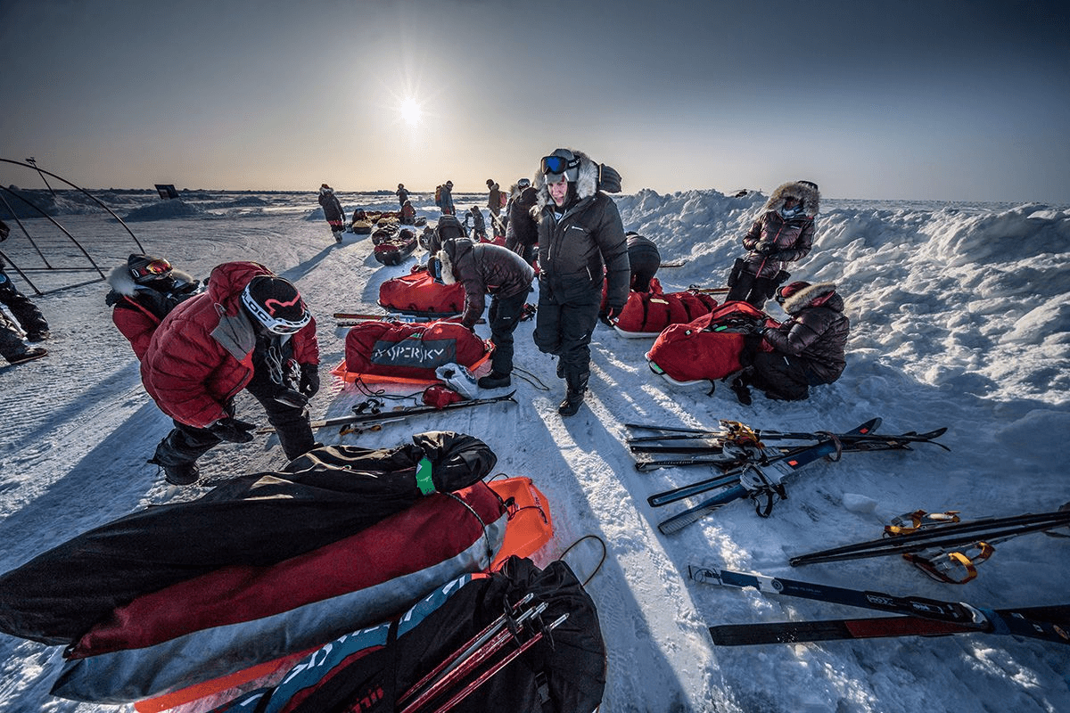 16.-Expedition-leder-Felicity-Aston-making-sure-all-sleds-are-are-accounted-for-after-the-hectic-unloading-from-the-An-71-aircraft-Photo-by-Renan-Ozturk