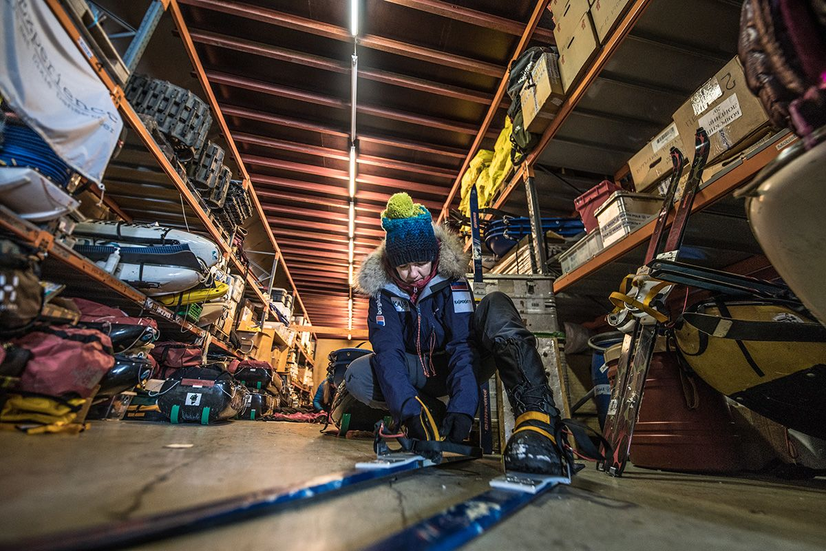 6.-Trying-on-the-skis-in-the-equipment-warehouse-in-Svalbard-pre-departure-to-make-sure-the-bindings-fit-properly-Photo-by-Renan-Ozturk