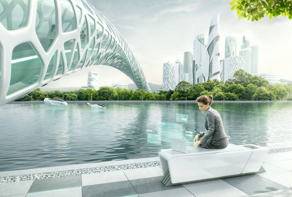 woman working at laptop in a futuristic city lake