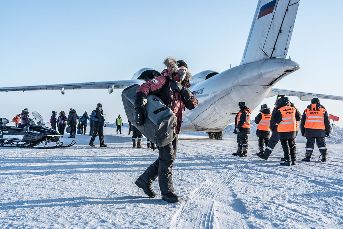15.-Unloading-the-expedition-equipment-from-the-An-71-aircraft-after-a-dramatic-landing-on-the-1km-ice-airstrip-at-Barneo-Polar-Station-Photo-by-Renan-Ozturk